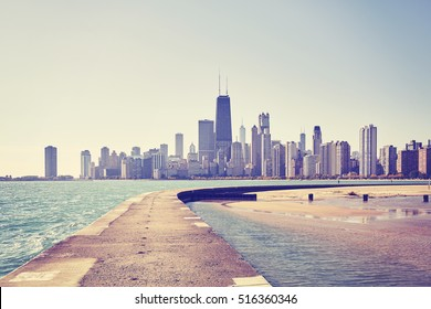 Vintage toned photo of Chicago city skyline seen from pier on Lake Michigan, USA.