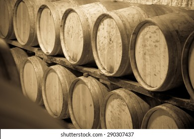 Vintage toned photo  of  winery cellar with  wooden barrels