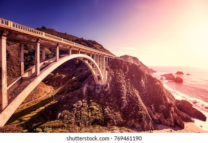 Vintage toned picture of the Bixby Creek Bridge at sunset, Pacific Coast Highway, California, USA.