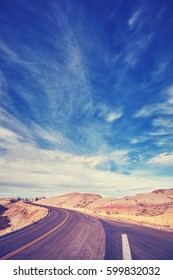 Vintage toned road in Badlands National Park, South Dakota, USA.