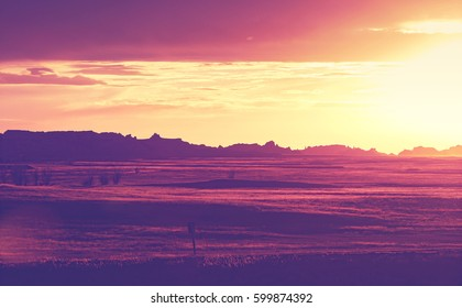 Vintage toned rock silhouettes in Badlands National Park at sunset, South Dakota, USA.