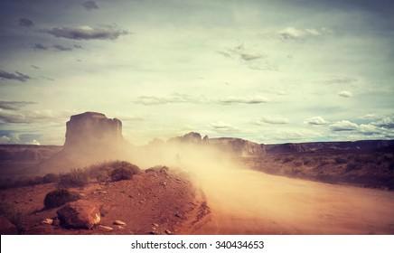 Vintage toned sandstorm over Monument Valley, Utah, USA.