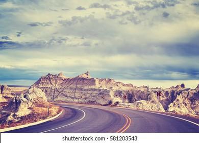 Vintage toned scenic road in Badlands National Park, South Dakota, USA.
