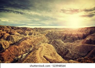 Vintage toned scenic sunset over Badlands National Park, South Dakota, USA.