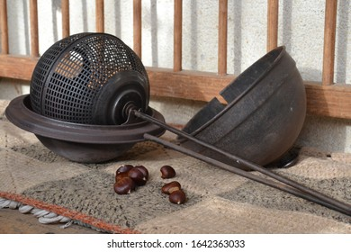 Vintage tool for baking chestnuts on a stove