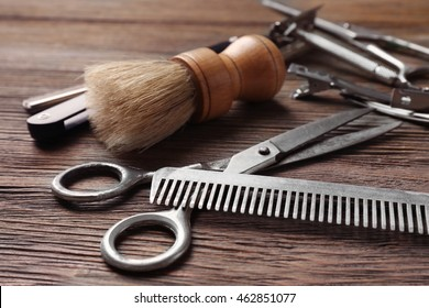Vintage tools of barber shop on wooden background