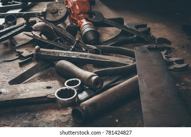 Vintage tools on a well worn workshop bench