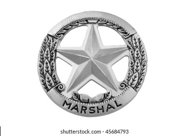 vintage toy deputy marshal star badge over white with a clipping path