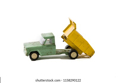 Vintage Toy Dump Truck on White
