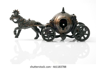 Vintage toy, horse carriage on white background.