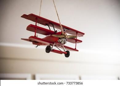vintage toy plane in kids room