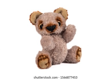 Vintage toy plush teddy bear isolated on white background