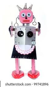 vintage toy robot walking toward you on a white background