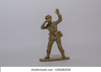 Vintage Toy soldier aiming on a white background