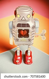Vintage Toy Tin Windup Robot with heart symbol in center