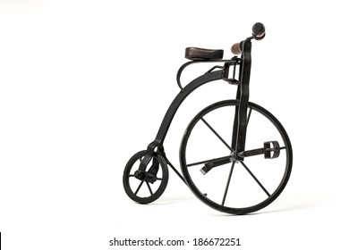 vintage toy velocipede isolated in white