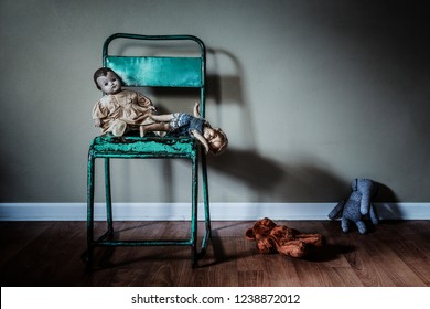 Vintage toys on a green metal chair abandoned in an empty room