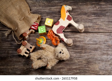 Vintage toys on wooden background