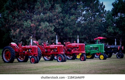 Vintage Tractors Farmall International and John Deere 08/29/2018 Crofton Nebraska USA Various Colors of Red, Green and Black