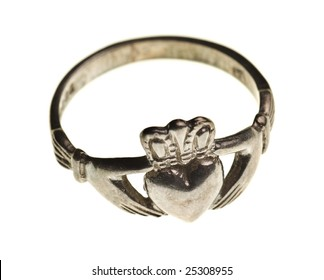 vintage traditional Claddagh ring isolated on a pure white background