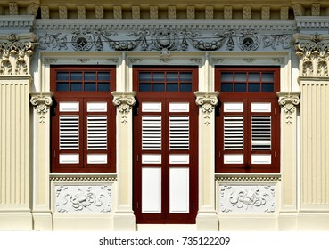 Vintage traditional Straits Chinese or Peranakan Singapore shop house  with ornate exterior and antique louvered shutters in historic Chinatown
