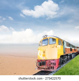 Vintage train with sea and blue sky