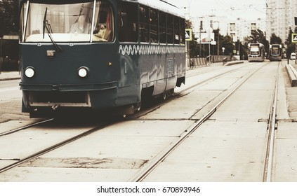 vintage tram rides on the street