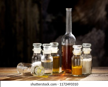 Vintage transparent small bottles on a wooden table