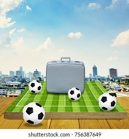 Vintage travel bag on football game board with cityscape background, Travel for sport concept