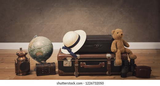 vintage travel bags and accessories on dark background with copy space , conceptual for travel