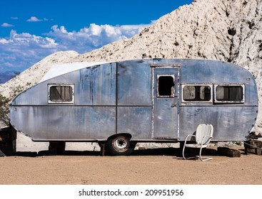 A vintage travel trailer in the Nevada desert