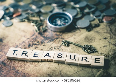 Vintage treasure hunting concept with coins and compass, for business wealth and success concept.