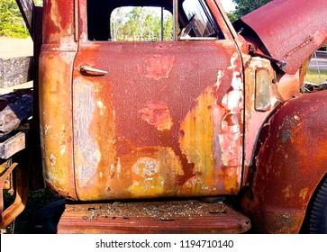 Vintage Truck rusting in field