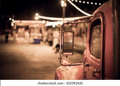 vintage truck under bokeh light from vintage shop and reflect in truck side mirror, effected by vintage style, retro color tone.