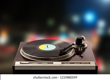 Vintage Turntable on disc background