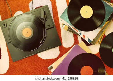 vintage turntable on orange carpet