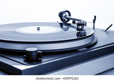 vintage turntable playing record