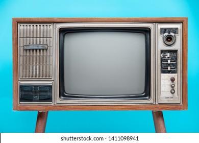 Vintage TV : old retro TV set isolated on blue background.