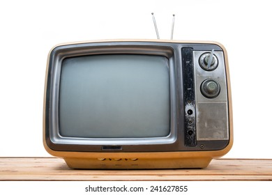 Vintage TV on wood table , isolated white background