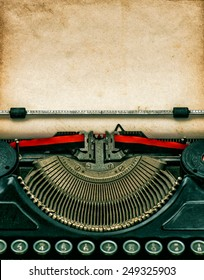 Vintage typewriter with aged textured grungy paper