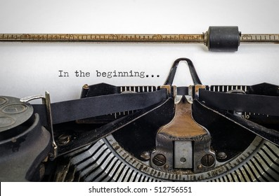 Vintage typewriter with ' In the beginning ' typed onto white paper with copy space.