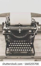 Vintage typewriter with clean paper