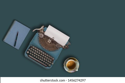 Vintage typewriter and coffee on green background.