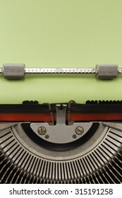 Vintage Typewriter With Empty Green Paper Sheet Vertical Photograph