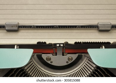 Vintage Typewriter With Empty Sheet of Paper With Lines