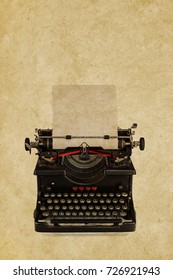 Vintage typewriter in front of a sepia toned weathered background