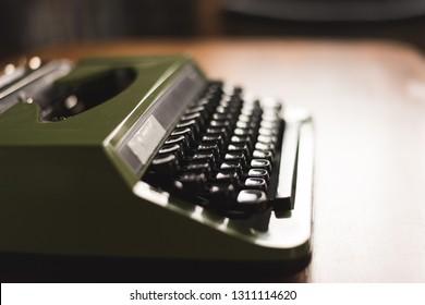 vintage typewriter in green color on the desk