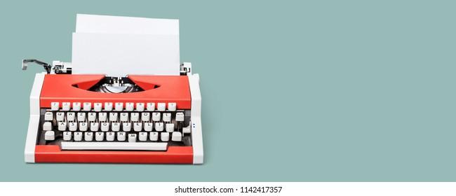 Vintage typewriter header with old paper