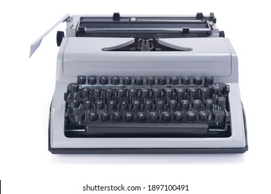vintage typewriter isolated at white background, old styled retro machine