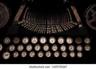 Vintage typewriter keys close up in dark moody warm light